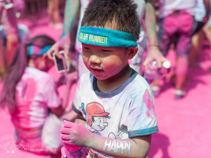 Chengdu, China - July 2, 2016 : Little boy enjoying the Chengdu color run
