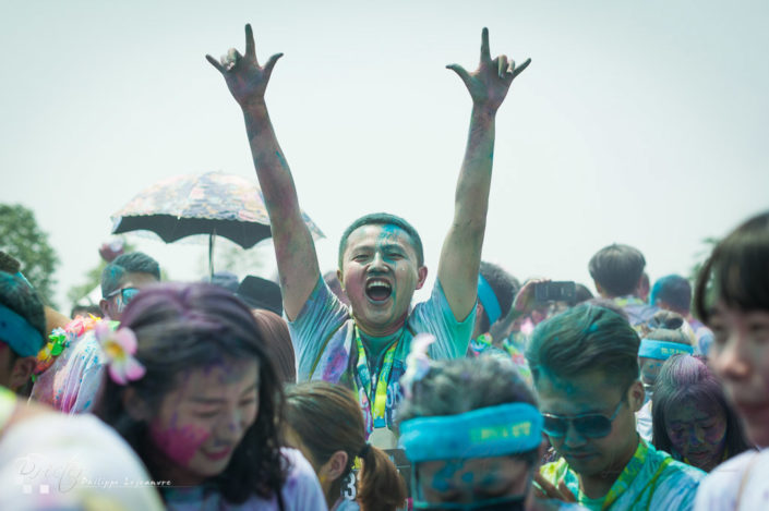 Chengdu, Sichuan province, China - July 2, 2016: Runners having fun at the Color Run China in Chengdu