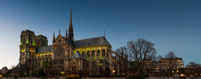 Notre-Dame de Paris illuminated at blue hour - panorama