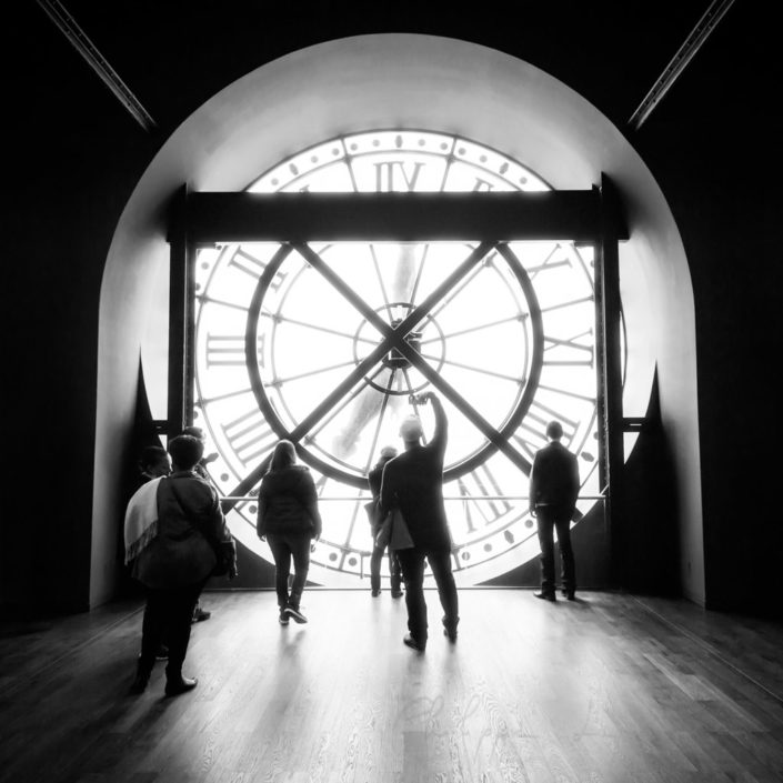 People behind Orsay museum clock in Paris