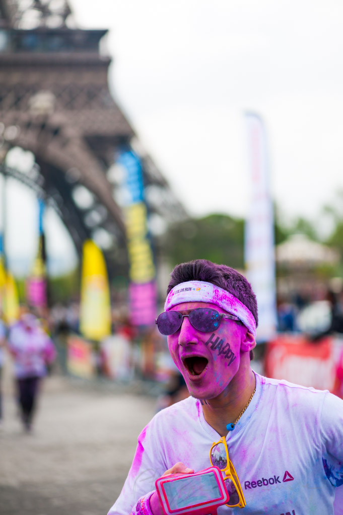 Paris, France - April 13, 2014: People covered with colored powder finishing the color run race under the Eiffel Tower.