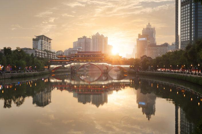 Anshun bridge reflecting in the Jinjiang river at sunset in Chengdu, Sichuan Province, China