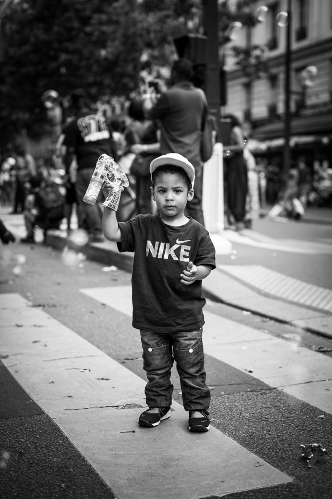 Little boy playing with bubble at the Paris tropical carnival, France