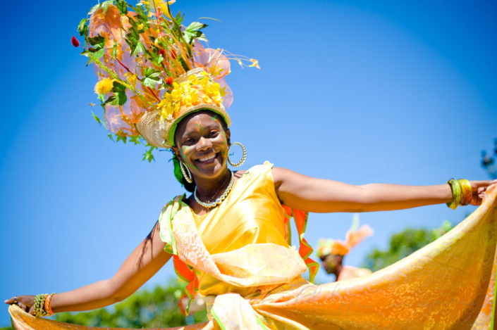 Young woman dancing in the streets of Paris at the annual summer tropical carnival, France