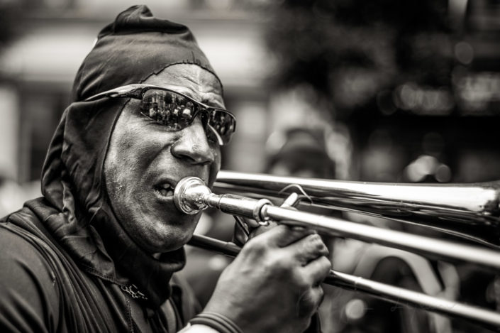 Man playing trombone at the Paris tropical carnival, France