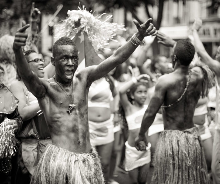 Young people dancing at the Paris tropical carnival, France