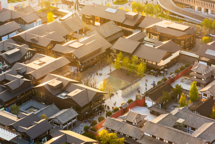 Chengdu - Buddhist temple and Taikooli roofs aerial view at sunset, Sichuan Province, China