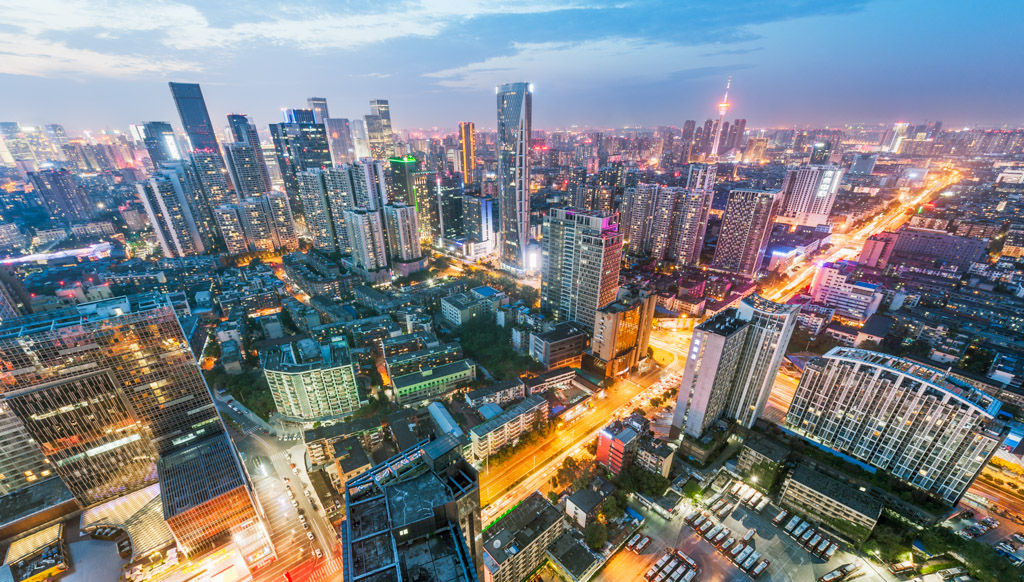 Chengdu skyline aerial view at dusk with multiple skyscrappers and lights from the city, Sichuan province, China
