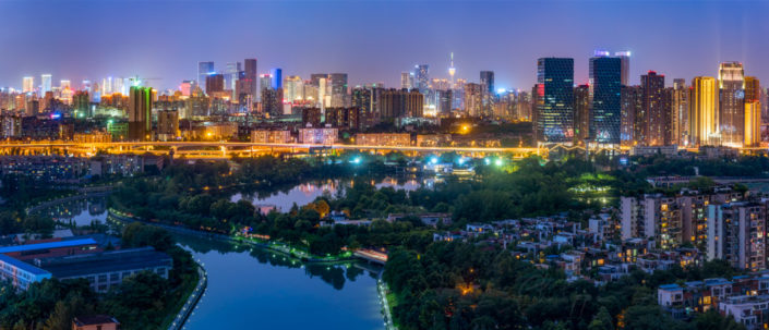 Chengdu city skyline panorama at night with a river in the foreground, Sichuan Province, China
