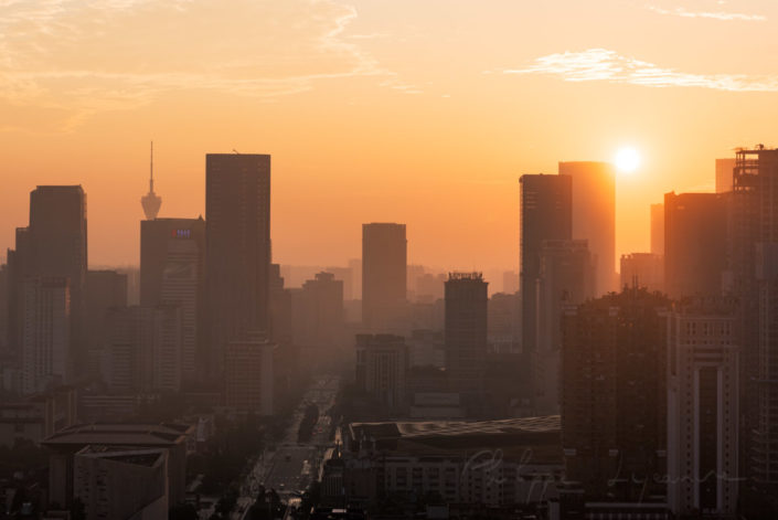 Chengdu skyline at sunrise with orange sky, Sichuan Province, China