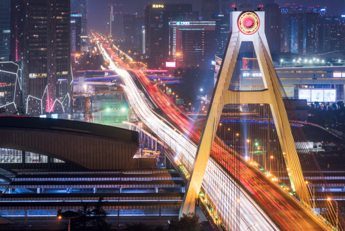 South railway station and bridge close-up with car traffic light trails at night, Chengdu, China