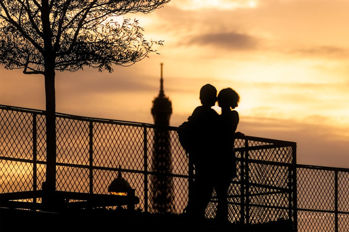 Young couple silhouette in Paris with the Eiffel tower in the background