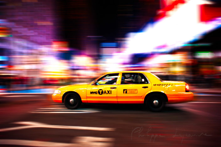 Yellow taxi at night in New York City, USA