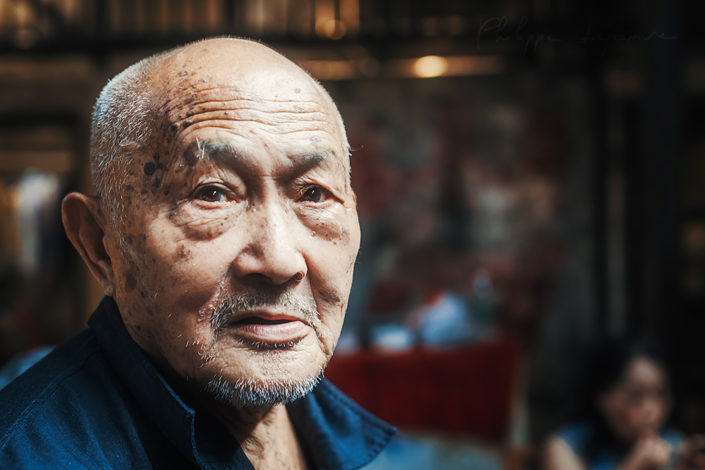 Portrait of an old chinese man in an ancient tearoom, Chengdu, Sichuan province, China