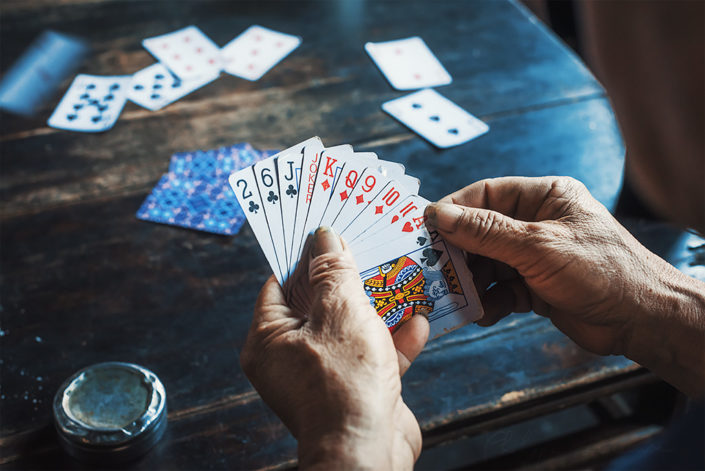 Hands of a chinese man playing cards in an ancient tearoom, Chengdu, Sichuan province, China