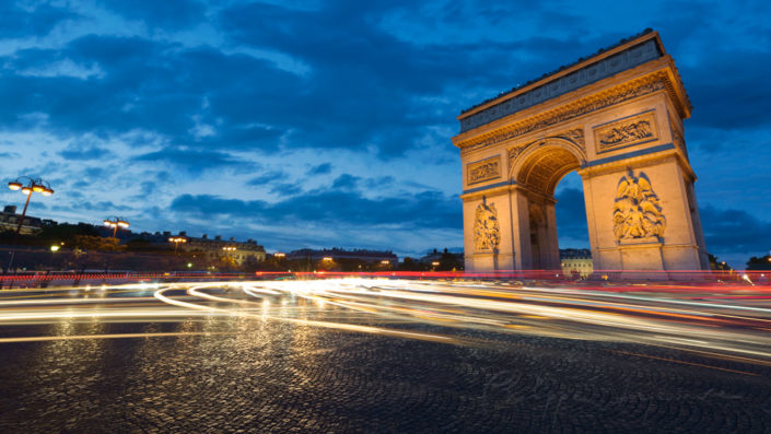 Paris - Arc de Triomphe and Place Charles de Gaulle at blue hour with car light trails