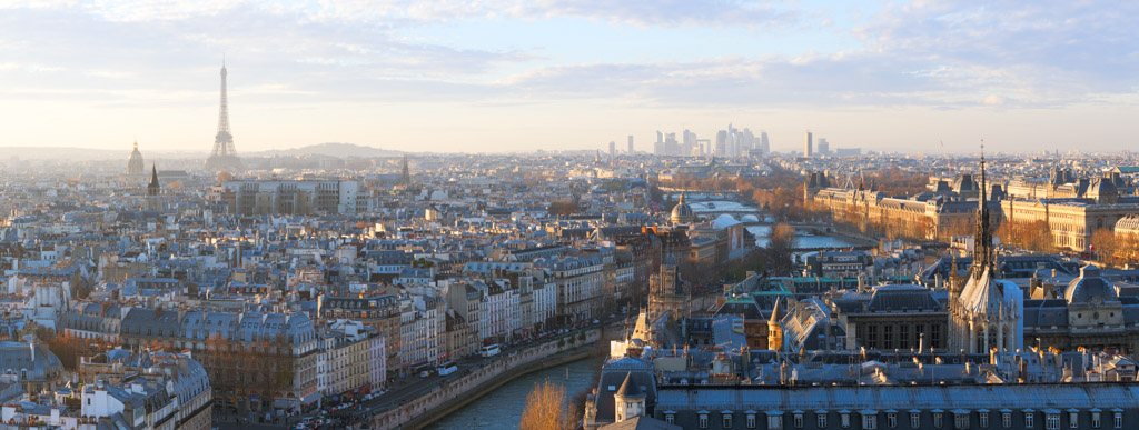 Paris skyline panorama at sunset with river Seine, France