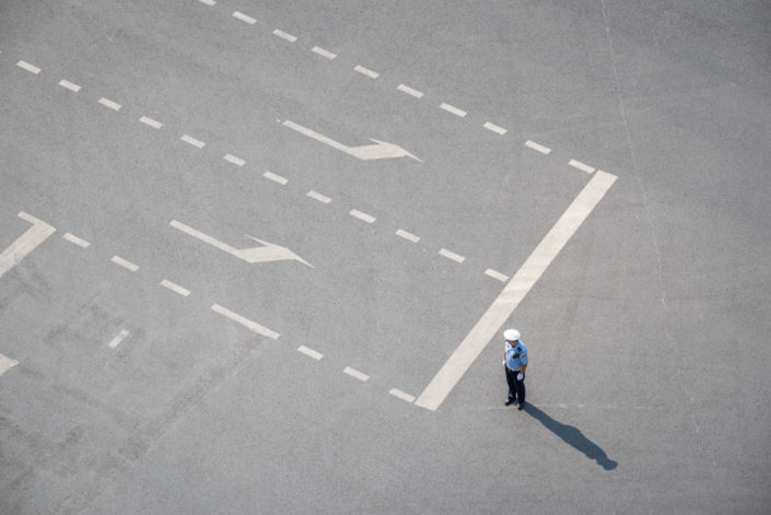 Policeman standing on a road aerial view in Chengdu, Sichuan province, China