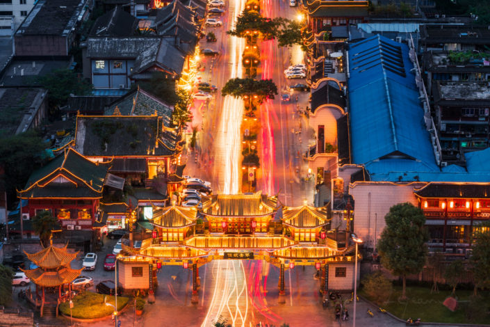 QinTaiLu chinese traditional gate illuminated at night aerial view with car light trails, Chengdu, China