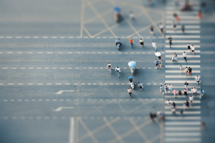 People crossing the road aerial view with tilt-shift effect in Chengdu, Sichuan province, China