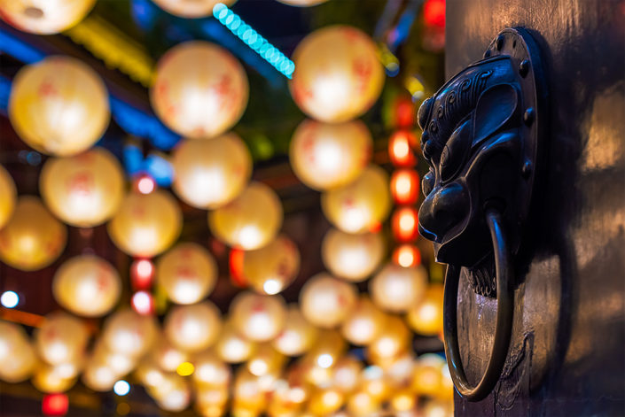 Chinese door knocker with chinese lanterns in the background in Jinli for the mid-autumn festival, Sichuan province, China
