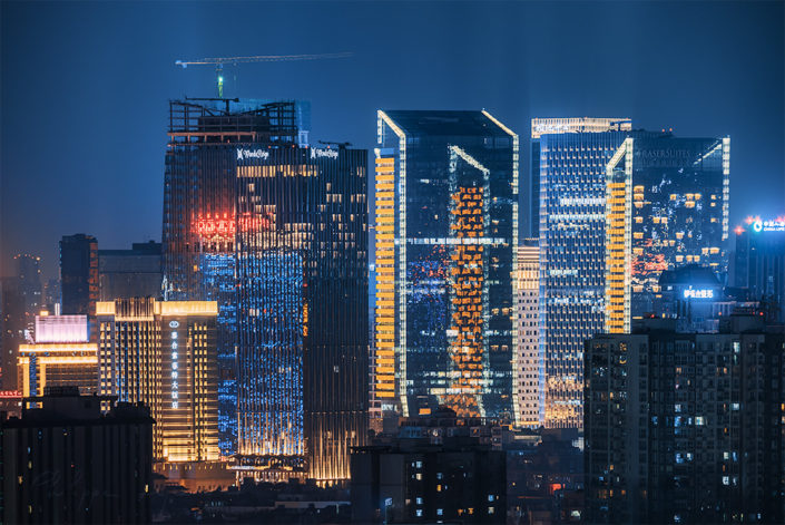 Fraser Suites and Wand buildings illuminated at night in Chengdu, Sichuan province, China