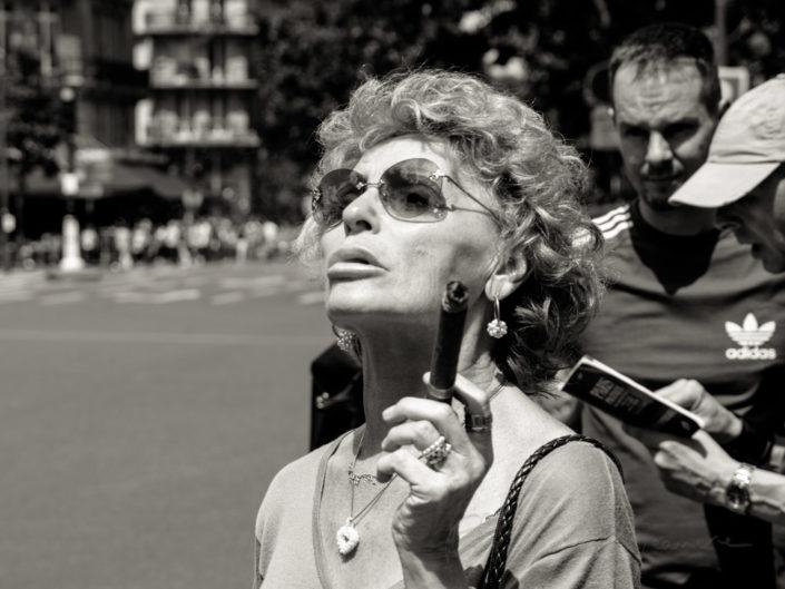 Senior woman smoking a cigar in Paris street, France