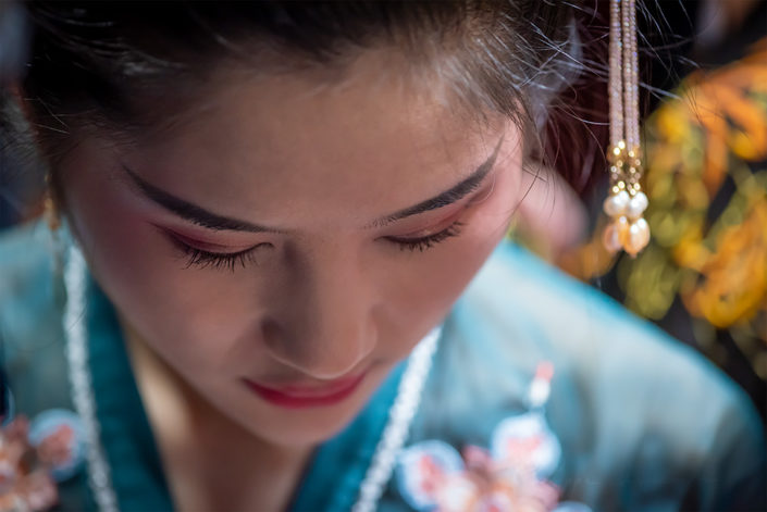 Young woman portrait with traditional clothes in Jinli for the mid-autumn festival, Chengdu, Sichuan province, China