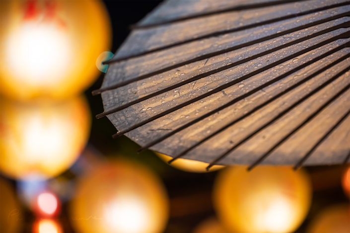 Chinese umbrella against chinese lanterns at night in Jinli for the mid-autumn festival, Sichuan province, China