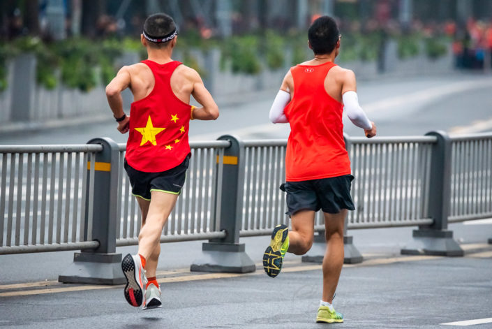 Chengdu, Sichuan province, China - Oct 27, 2019 : Two men with red t-shirts running at the Chengdu marathon