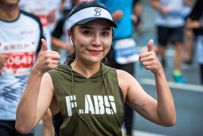 Chengdu, Sichuan province, China - Oct 27, 2019 : Young woman running at the Chengdu marathon