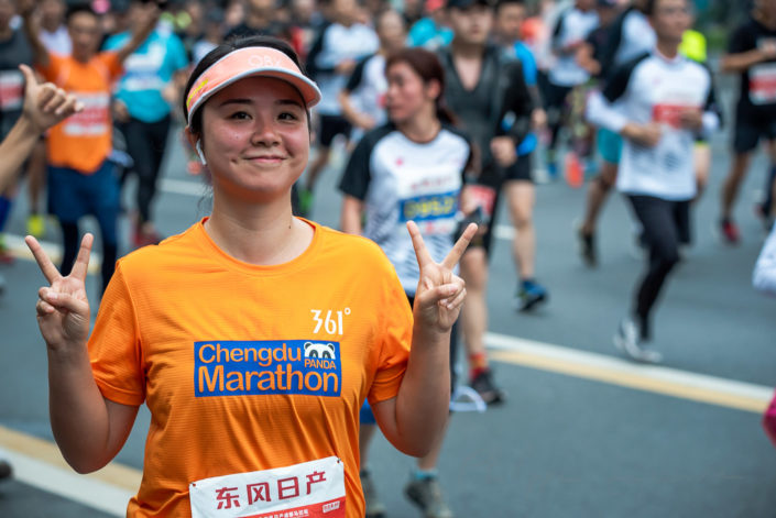 Chengdu, Sichuan province, China - Oct 27, 2019 : Young woman running at the Chengdu marathon