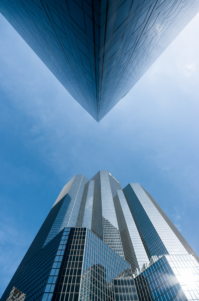 Vertical low angle view of two buildings facing each other in the business suburb of La Defense, Paris