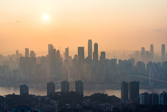 Chongqing skyline aerial view in the haze against sun, China