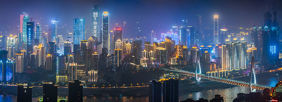 Chongqing illuminated skyline aerial view at night, China