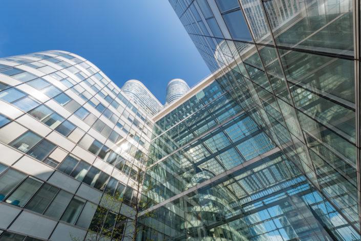 Coeur Defense tower against blue sky in La Defense business district in Paris, France