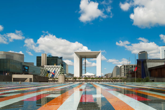 Grande-Arche de La Defense and buildings reflecting in the Agam basin - Paris, France