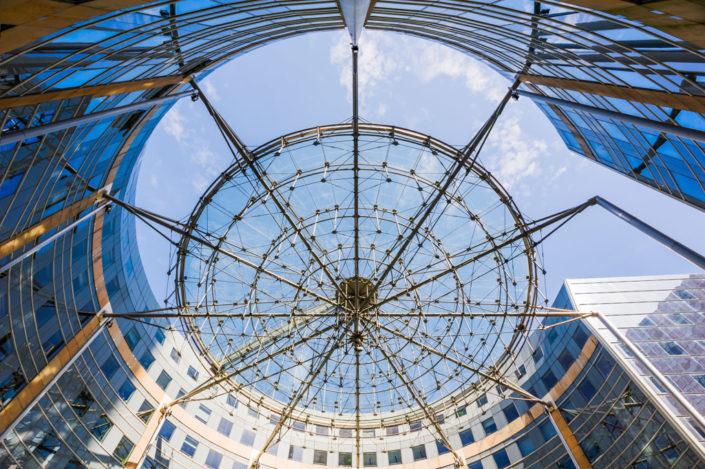 Les Villages de l'Arche building against blue sky, La Defense business district, Paris, France