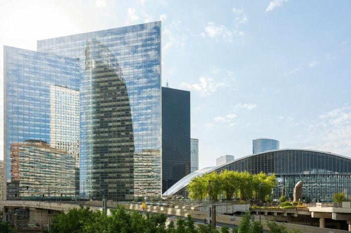 La Defense business district buildings reflections against blue sky, Paris, France