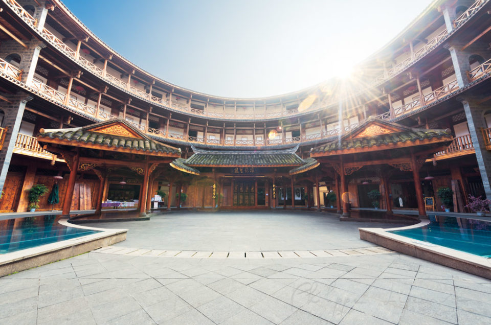 Luodai, Sichuan Province, China : Hakka traditional round house with sunrays above the roof.