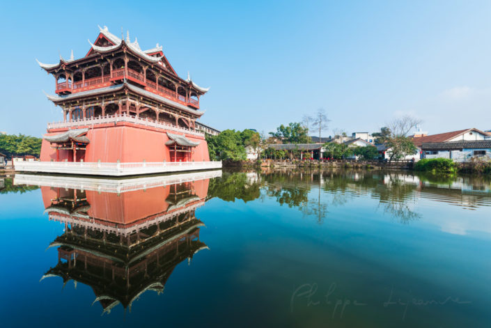 Luodai, Sichuan Province, China : Wufeng tower reflecting in the water