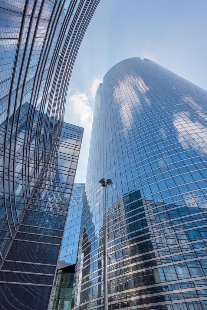 Societe generale modern glass buildings against blue sky in La Defense business district, Paris, France