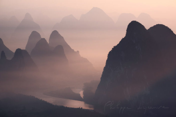 Mountain landscape in the mist at dawn with Li river in Xingping, Yangshuo, Guilin, Guangxi province, China