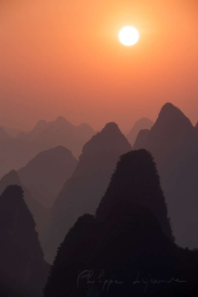 Sunrise behind mountains landscape in Xingping, Yangshuo, Guilin, Guangxi province, China