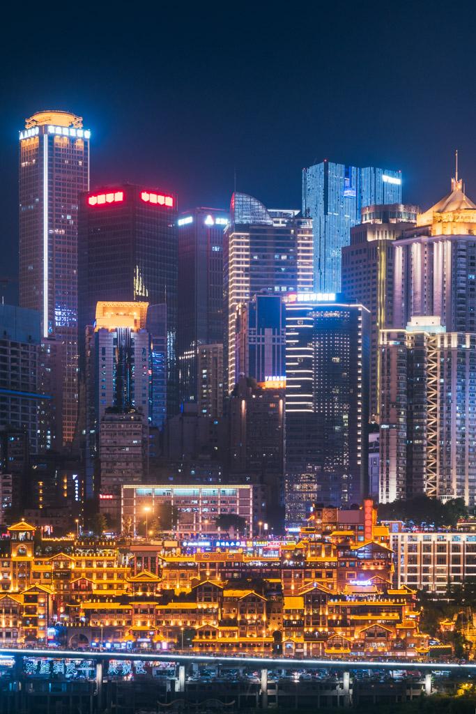 Hongya cave with illuminated skyscrapers at night in Chongqing, China
