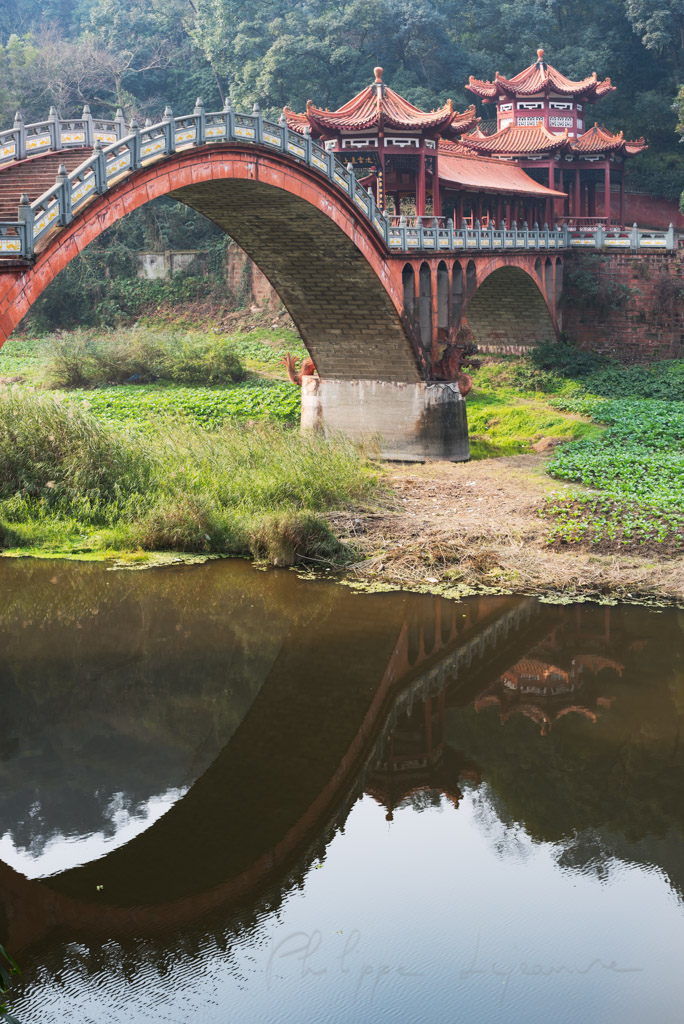 Leshan - Chengdu - ZhuoYing ancient bridge refecting in the river, Sichuan Province, China
