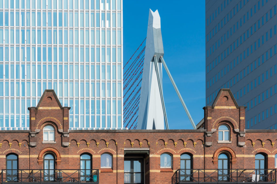 Rotterdam, Netherlands : Old and new architecture with Erasmus bridge in Wilhelminapier district.