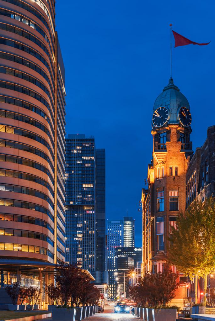 Buildings illuminated at night in Wilhelminapier district, Rotterdam, Netherlands