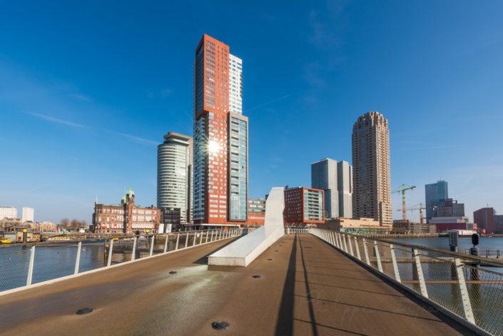 Rotterdam bridge and modern architecture in Wilheminapier with blue sky, Netherlands