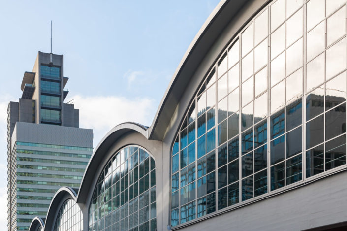 Rotterdam, Netherlands : Rotterdam cruise terminal arch windows with buildings in the background in Wilhelminapier district.